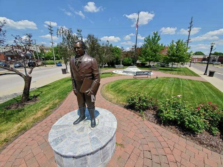 The statue of a former political figure and slave owner, Ninian Edwards, stands in Ninian Edwards Plaza at the corner of St. Louis and W. Vandalia streets in Edwardsville. A Facebook group, Remove the Ninian Edwards Statue and Rename Ninian Edwards Plaza, has grown to almost 500 members in support of petitioning the city to tear down the statue and rename the plaza in which it stands. Photo: Tyler Pletsch | Intelligencer