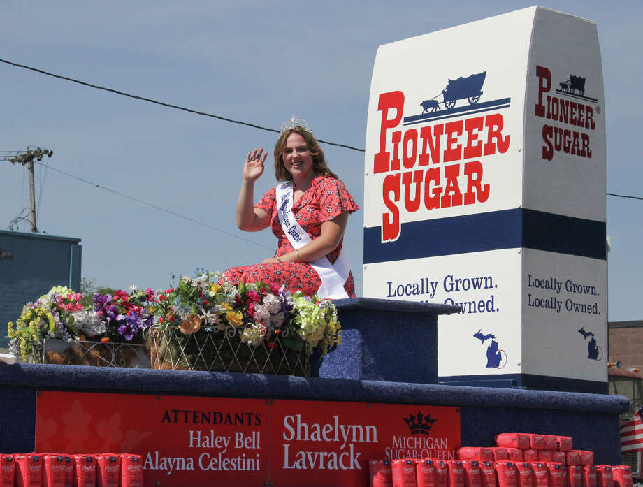 In place of the Grand Parade, the Michigan Sugar Company hosted its own mini-parade though Sebewaing on Saturday morning. The parade featured Sebewaing firefighters, police, EMS and the newly crowned 2020 Michigan Sugar Queen and attendants. Photo: Mark Birdsall/Huron Daily Tribune