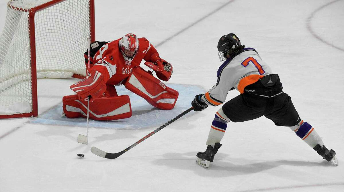 Greenwich goalie Charlie Zolin makes a save against Stamford-Westhill Co-op's Gavin Dolan (7) in January 2020 game.
