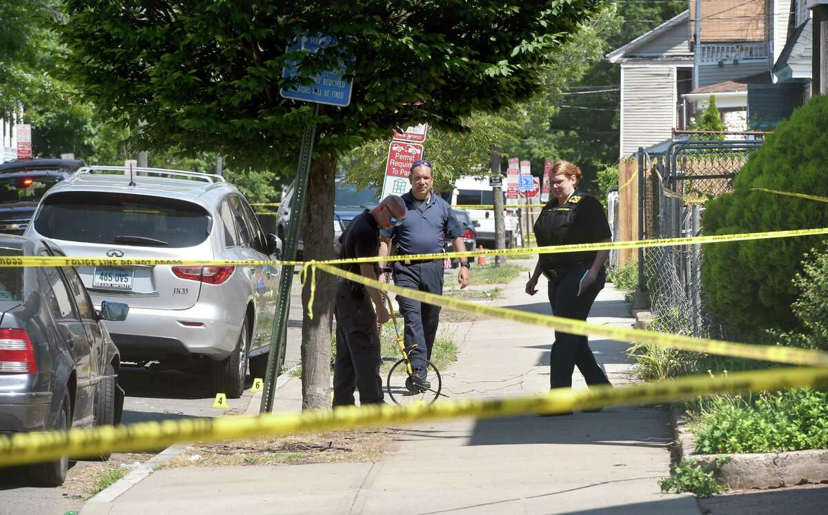 New Haven Police investigate the scene on Elliot Street in New Haven where a man was shot and killed around 3:00 a.m. on June 20, 2020.
