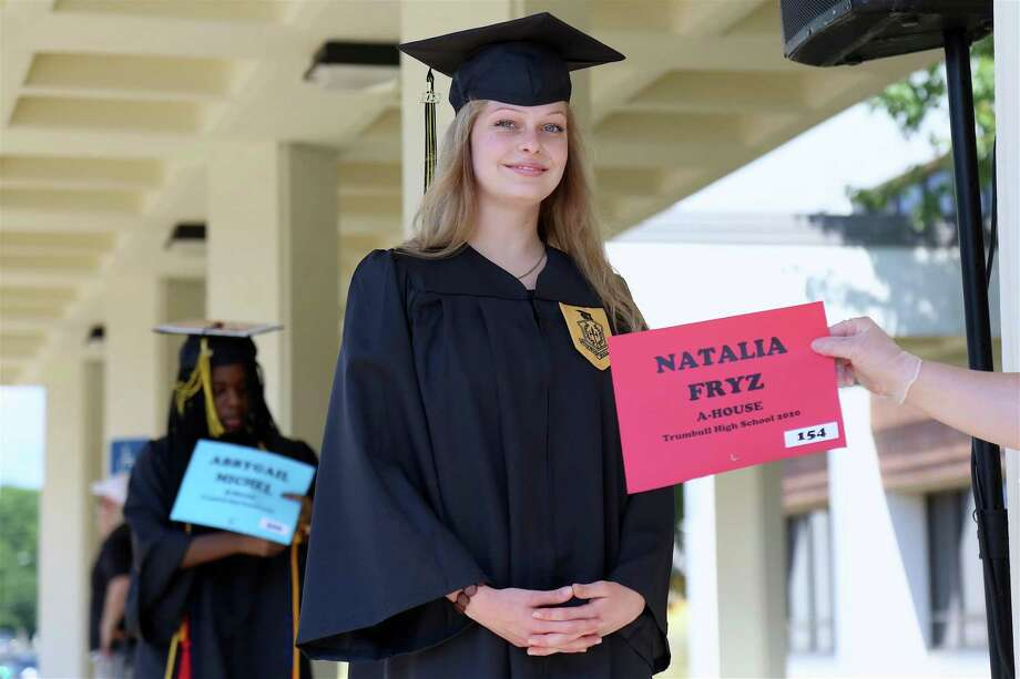 Natalia Fryz waits to receive her diploma cover. Photo: Jaret Liotta /