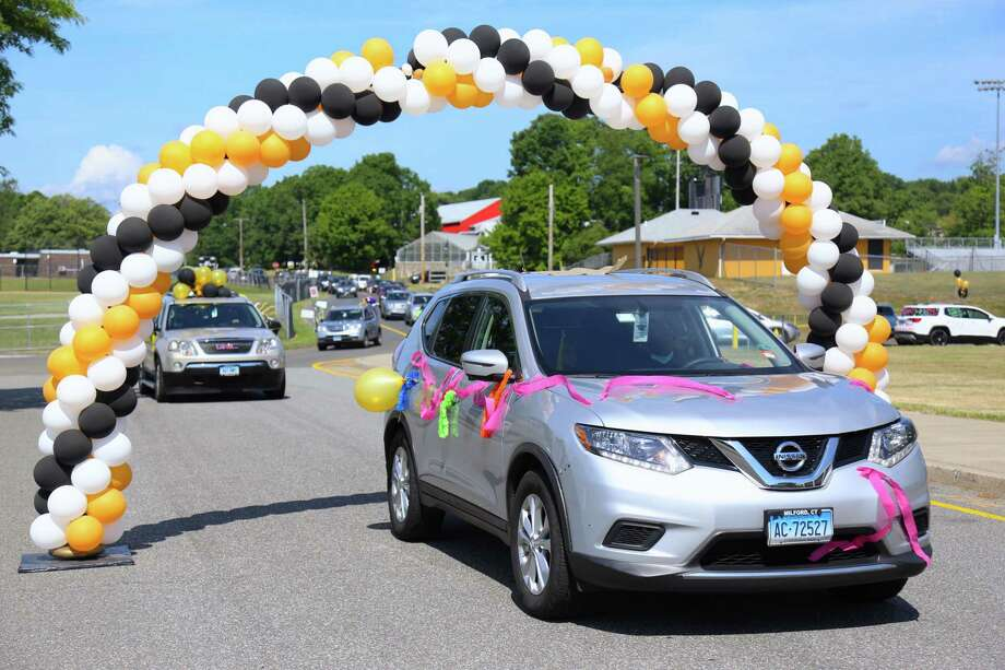Cars pass under one of several balloon archways before students reached the staging areas to make their Trumbull High School graduation official. TRUMBULL — It wasn't the traditional ceremony, but school officials made it a memorable one when Trumbull High School's class of 2020 was graduated on Saturday. Scheduled at 90-minute intervals beginning at 9:15 a.m., groups of 30 or so vehicles — each containing a senior and their family — were directed to one of three staging areas around the school. Photo: Jaret Liotta /