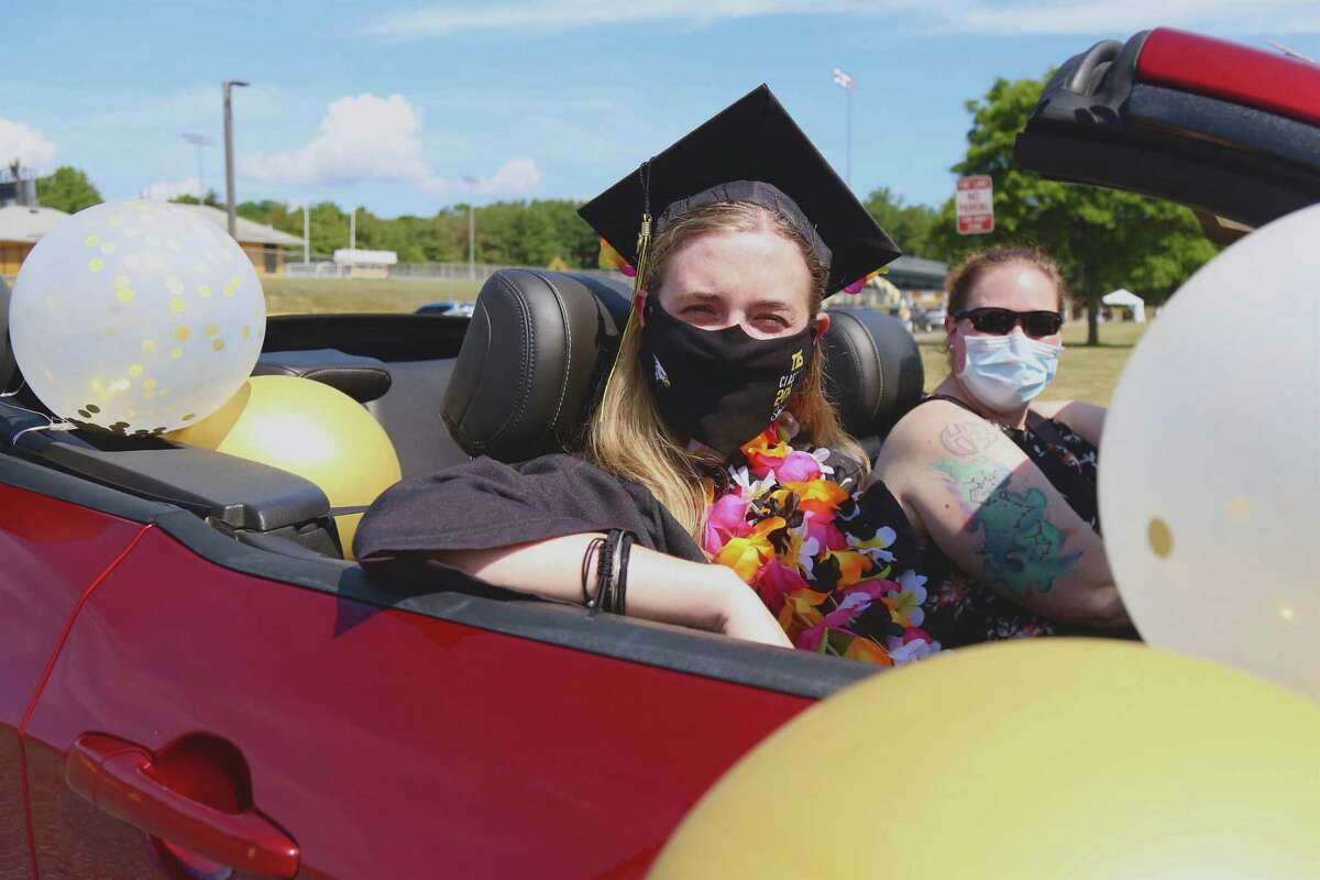 """Trumbull High School Class of 2020 graduate Mackenize Minor arrives in style for the graduation. """"It feels a lot better than nothing,"""" said senior Mackenzie Minor. """"I'm just happy to be graduating at all."""""""