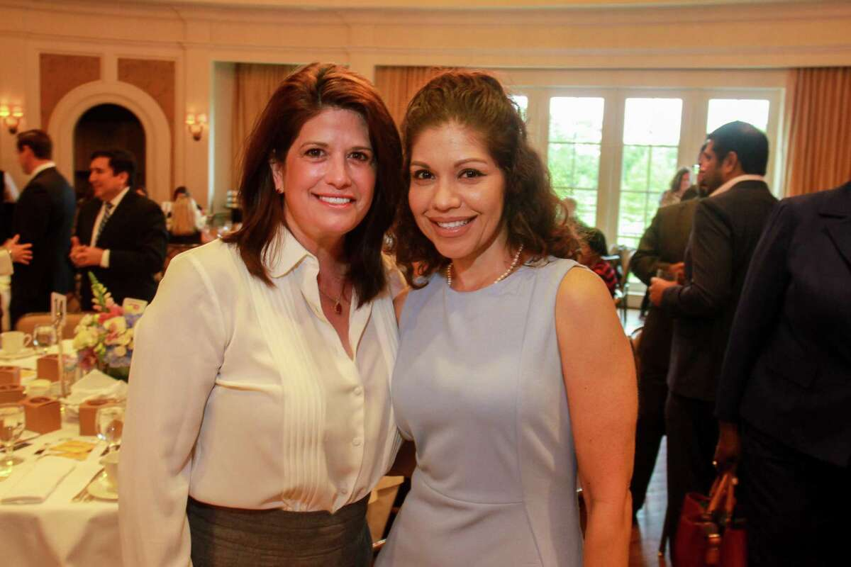 Dr. Adriana Tamez, left, and Dr. Melissa Gonzalez at the Houston Center for Literacy 2017 Mayor's Literacy Leadership Award Breakfast. (For the Chronicle/Gary Fountain, June 1, 2017)