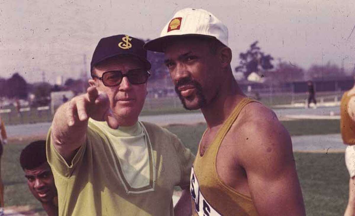 San Jose State track coach Bud Winter and sprinter John Carlos in 1969 at what became Bud Winter Field and is now a parking lot.