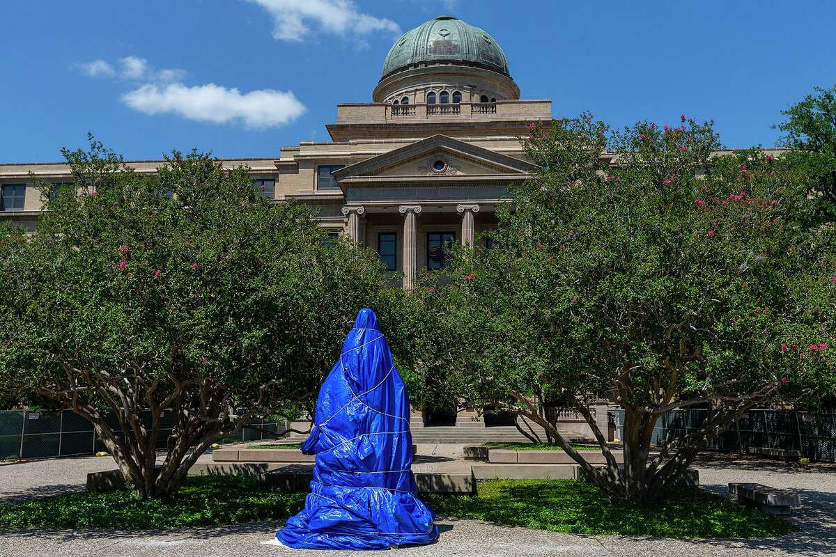 The Lawrence Sullivan Ross statue on the Academic Plaza of the Texas A& University campus in College Station remains covered Wednesday after it was defaced last week.