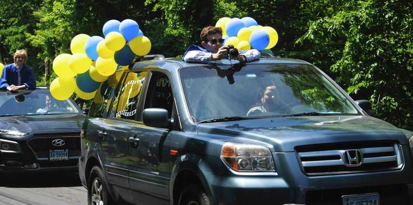 Brookfield High School graduates paraded from Whisconier Middle School to the high school where they received their diplomas, a goodie bag and posed for pictures on June 20, 2020. Police cars led the 200 graduates and their families, many of whom waved from cars decked out in blue and yellow balloons, streamers and decorated with paint. Some of the cars also announced the seniors' selected college for the fall.