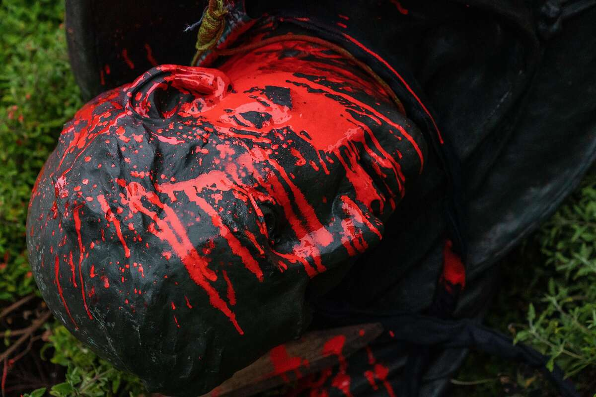 The statue of Junipero Serra is covered in red paint after protestors pulled it to the ground in Golden Gate Park, San Francisco, Calif., on Friday, June 19, 2020.