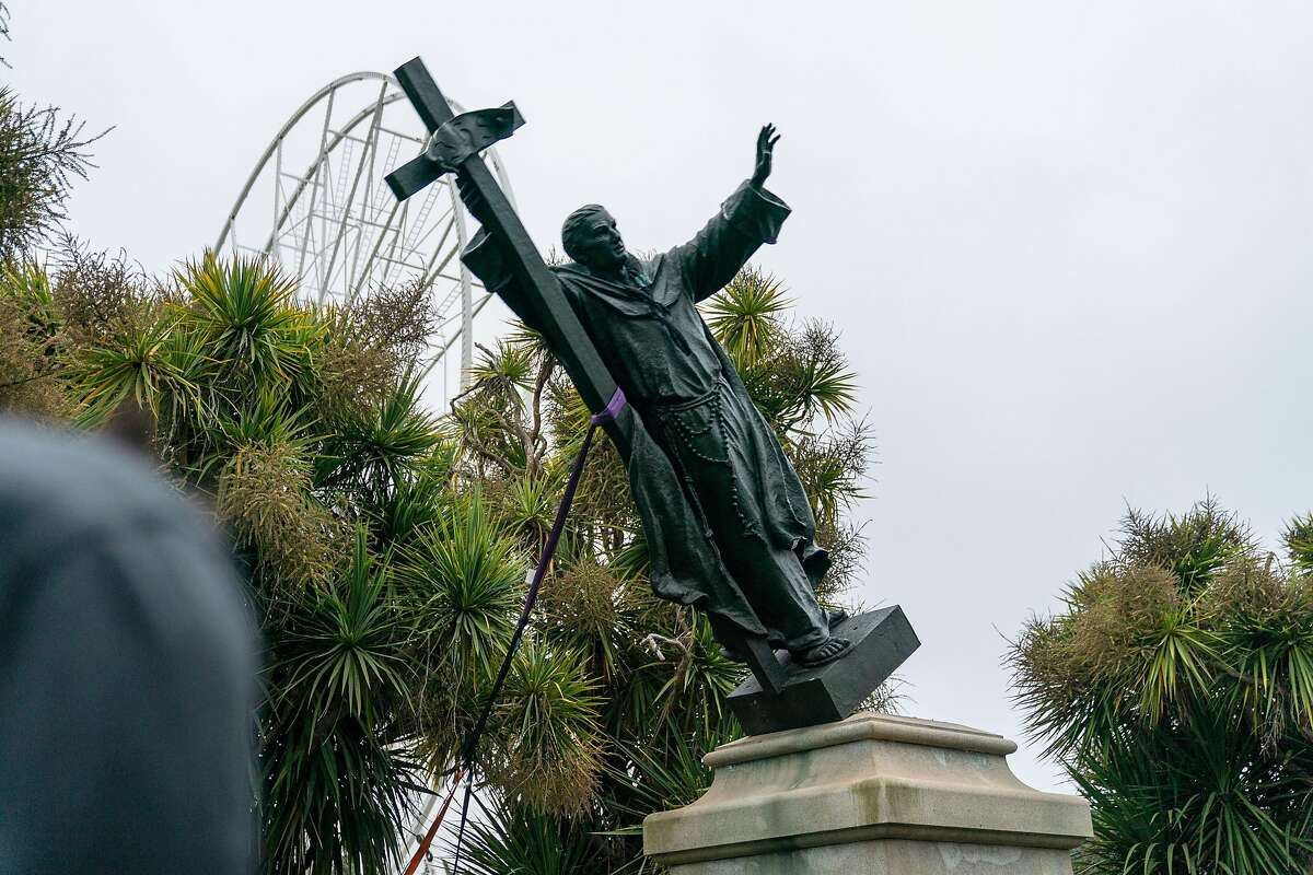 The statue of Junipero Serra is pulled to the ground by protestors in Golden Gate Park, San Francisco, Calif., on Friday, June 19, 2020.