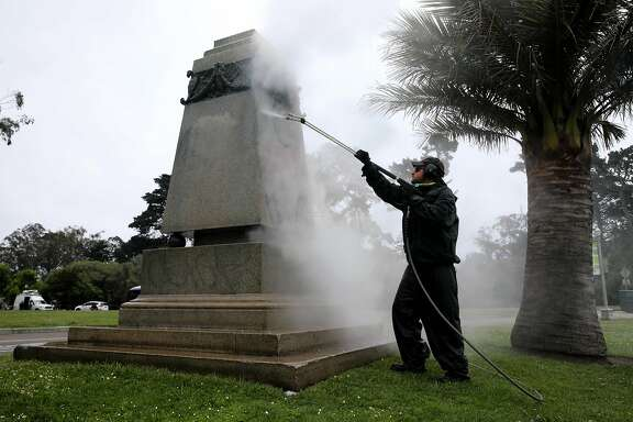 James McCormick, 3422: Park Section II Supervisor, Japanese Tea Garden and Music Concourse, San Francisco Recreation and Parks, pressure washes the pedestal of Ulysses S. Grant after the statue was toppled and the base defaced at Golden Gate Park, on Saturday, June 20, 2020, in San Francisco, Calif.