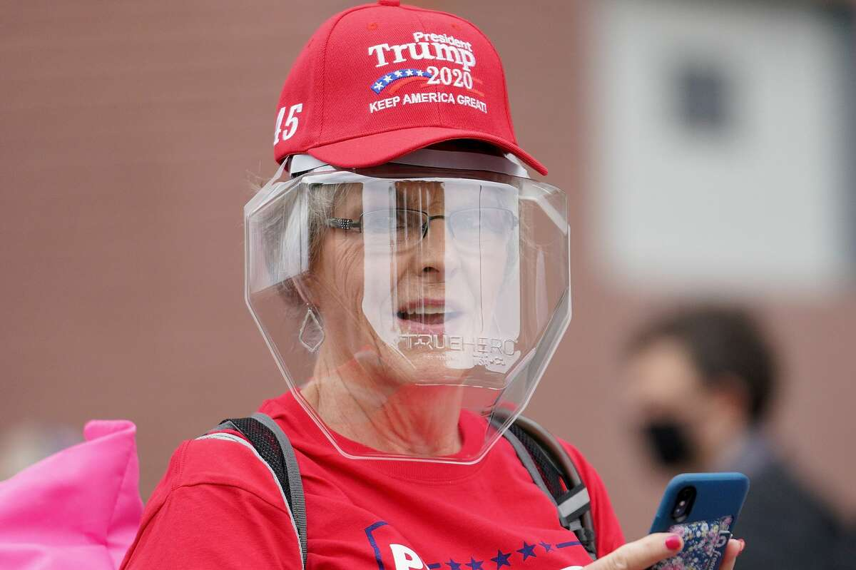 A woman wears a protective facemask while waiting to enter the BOK Center for a campaign rally for President Donald Trump on June 20, 2020 in Tulsa, Oklahoma. Trump is scheduled to hold his first political rally since the start of the coronavirus pandemic at the BOK Center on Saturday while infection rates in the state of Oklahoma continue to rise. (Photo by Michael B. Thomas/Getty Images)