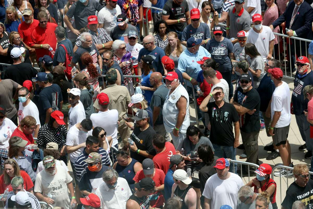 Supporters of U.S. President Donald Trump converge to enter a campaign rally at the BOK Center, June 20, 2020 in Tulsa, Oklahoma. Trump is scheduled to hold his first political rally since the start of the coronavirus pandemic at the BOK Center today while infection rates in the state of Oklahoma continue to rise. (Photo by Win McNamee/Getty Images)