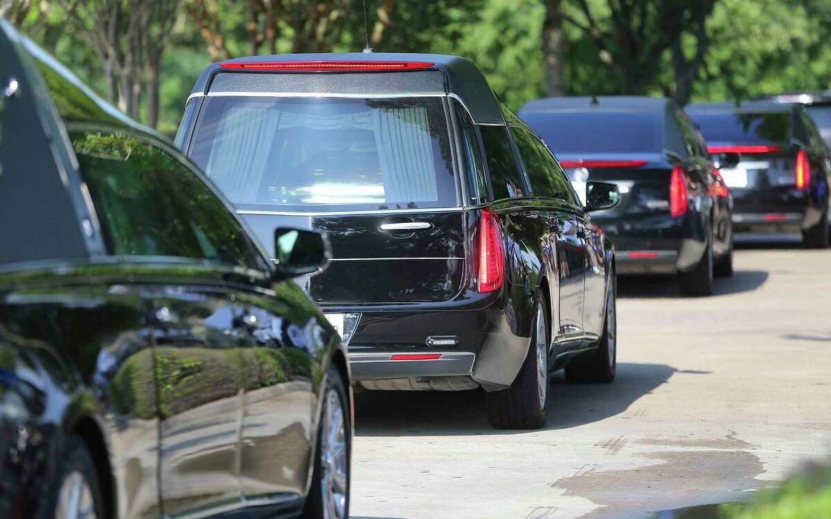 A hearse carrying George Floyd's casket makes its way to The Fountain of Praise Church in Houston on Tuesday, June 9, 2020.