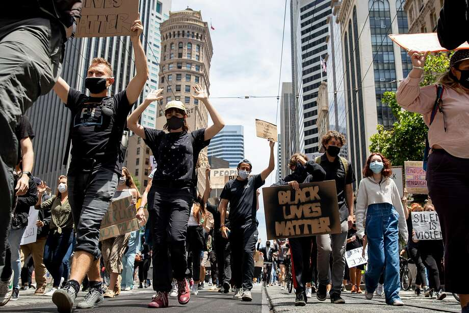 Demonstrators march down Market Street in San Francisco during a Black Lives Matter protest in June. Photo: Jessica Christian / The Chronicle