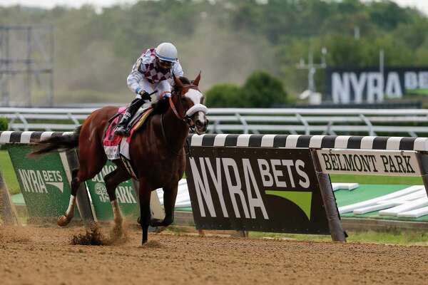 Tiz the Law (8), with jockey Manny Franco up, crosses the finish line to win the152nd running of the Belmont Stakes horse race, Saturday, June 20, 2020, in Elmont, N.Y. (AP Photo/Seth Wenig)