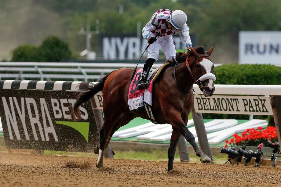 Tiz the Law (8), with jockey Manny Franco up, crosses the finish line to win the152nd running of the Belmont Stakes horse race, Saturday, June 20, 2020, in Elmont, N.Y. (AP Photo/Seth Wenig) Photo: Seth Wenig, Associated Press / Copyright 2020 The Associated Press. All rights reserved.