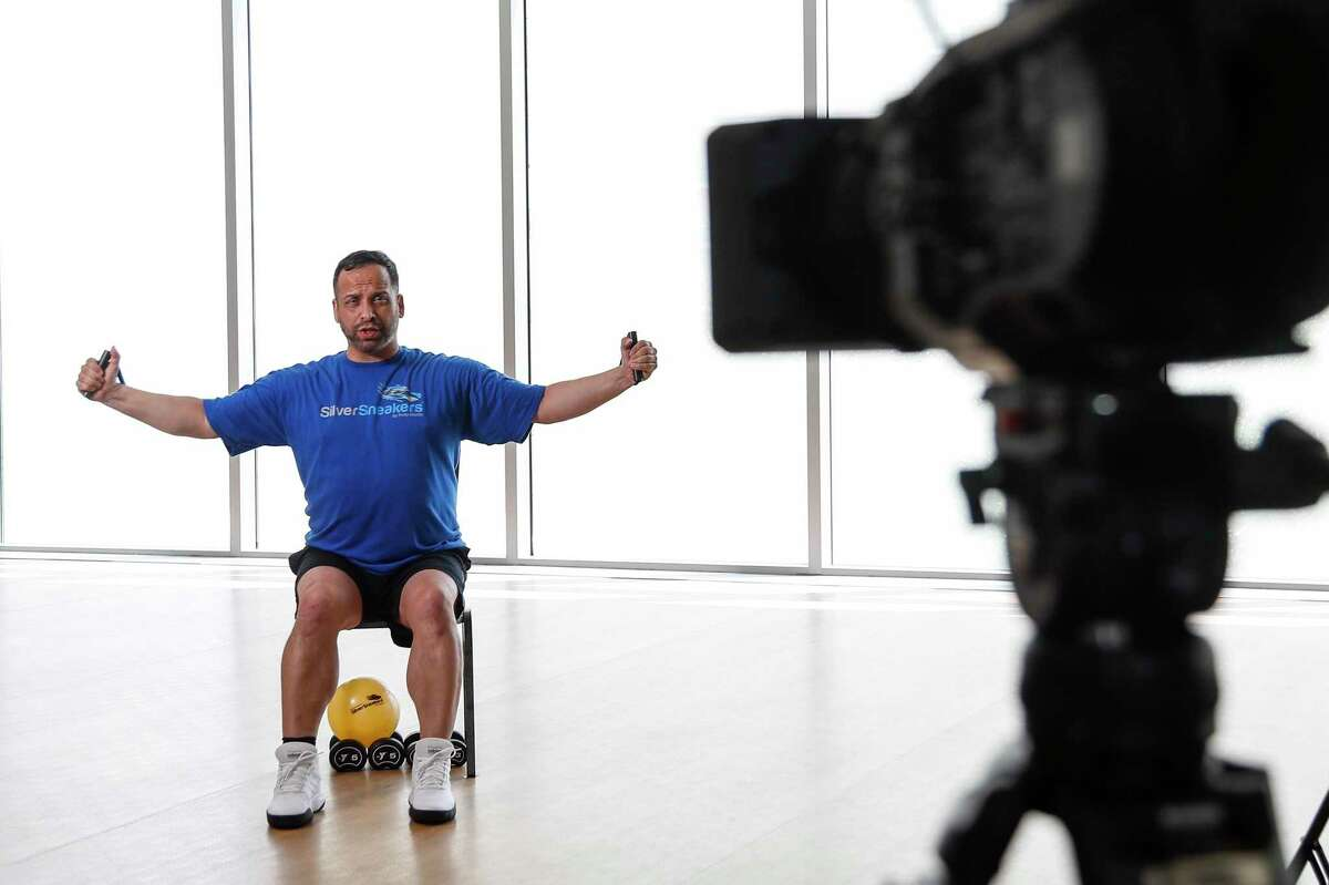 Eliot Perez, who was voted the top U.S. fitness instructor for Silver Sneakers, a program that serves only the 70+ population, this year, poses for a photo at the Tellepson Family Downtown YMCA, Saturday, June 13, 2020, in Houston. Perez's classes have been cut due to the pandemic, but he is conducting livestream sessions during the week.