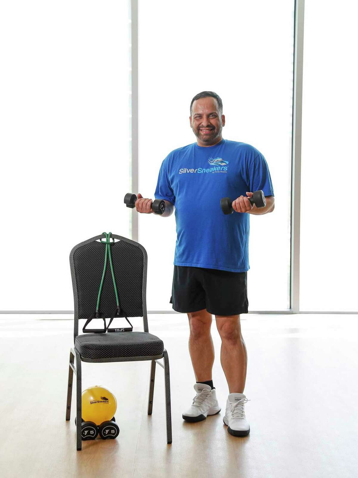 Eliot Perez, who was voted the top U.S. fitness instructor for Silver Sneakers, a program that serves only the 70+ population, this year, poses for a photo at the Tellepson Family Downtown YMCA, Saturday, June 13, 2020, in Houston.