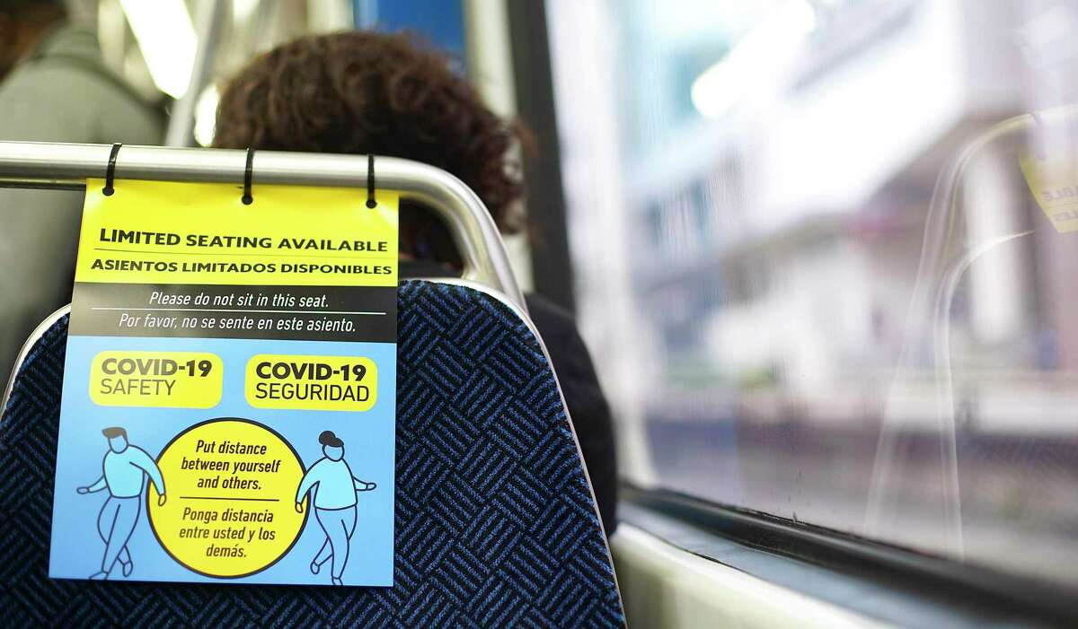 Every other seat on the Metro in downtown Houston had reminders about social distancing on March 24.