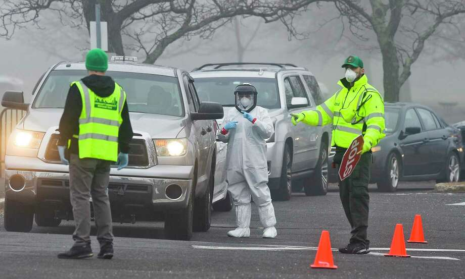 File photo of medical personnel from Murphy Medical Associates at a drive-thru screening for the COVID-19 coronavirus at a mobile testing site set up at Cummings Beach in Stamford, Conn., March 20, 2020. Photo: Matthew Brown / Hearst Connecticut Media / Stamford Advocate