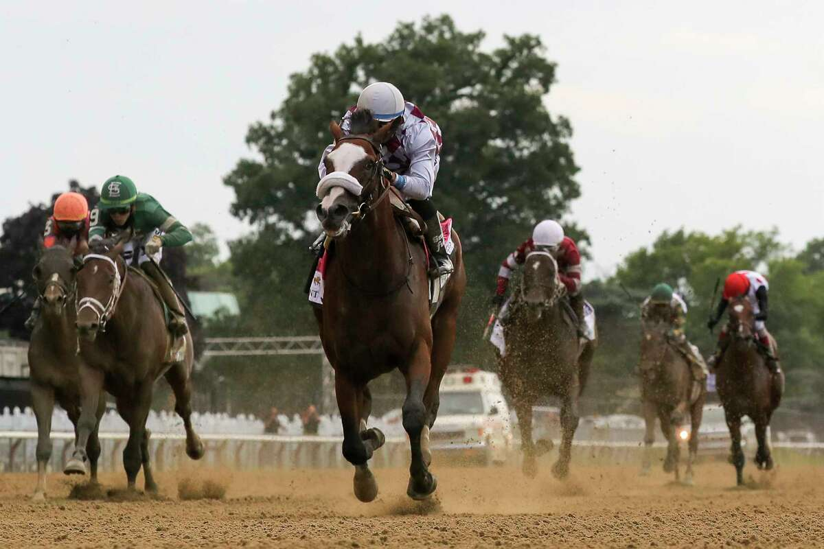 Tiz the Law, center, with jockey Manny Franco up, crosses the finish line to win the152nd running of the Belmont Stakes horse race, Saturday, June 20, 2020, in Elmont, N.Y.