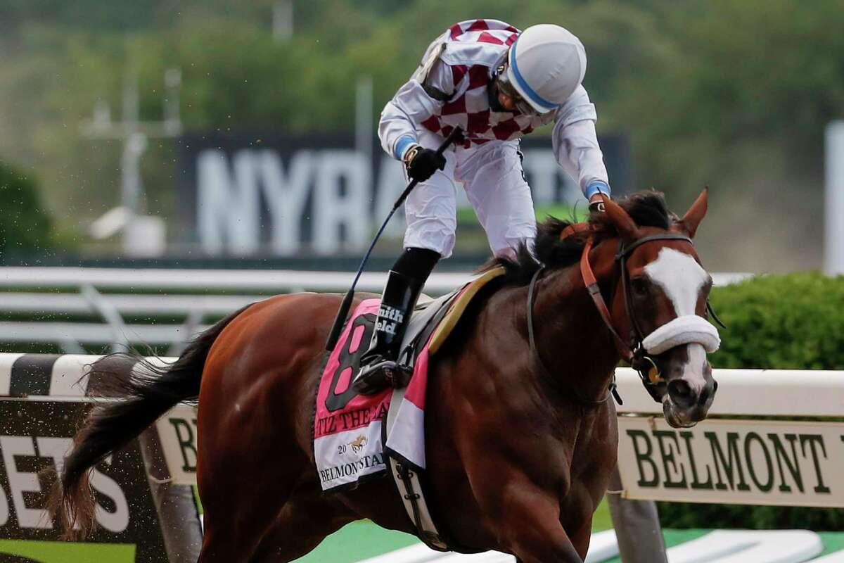 Tiz the Law (8), with jockey Manny Franco up, crosses the finish line in front of an empty grandstand to win the152nd running of the Belmont Stakes horse race, Saturday, June 20, 2020, in Elmont, N.Y.