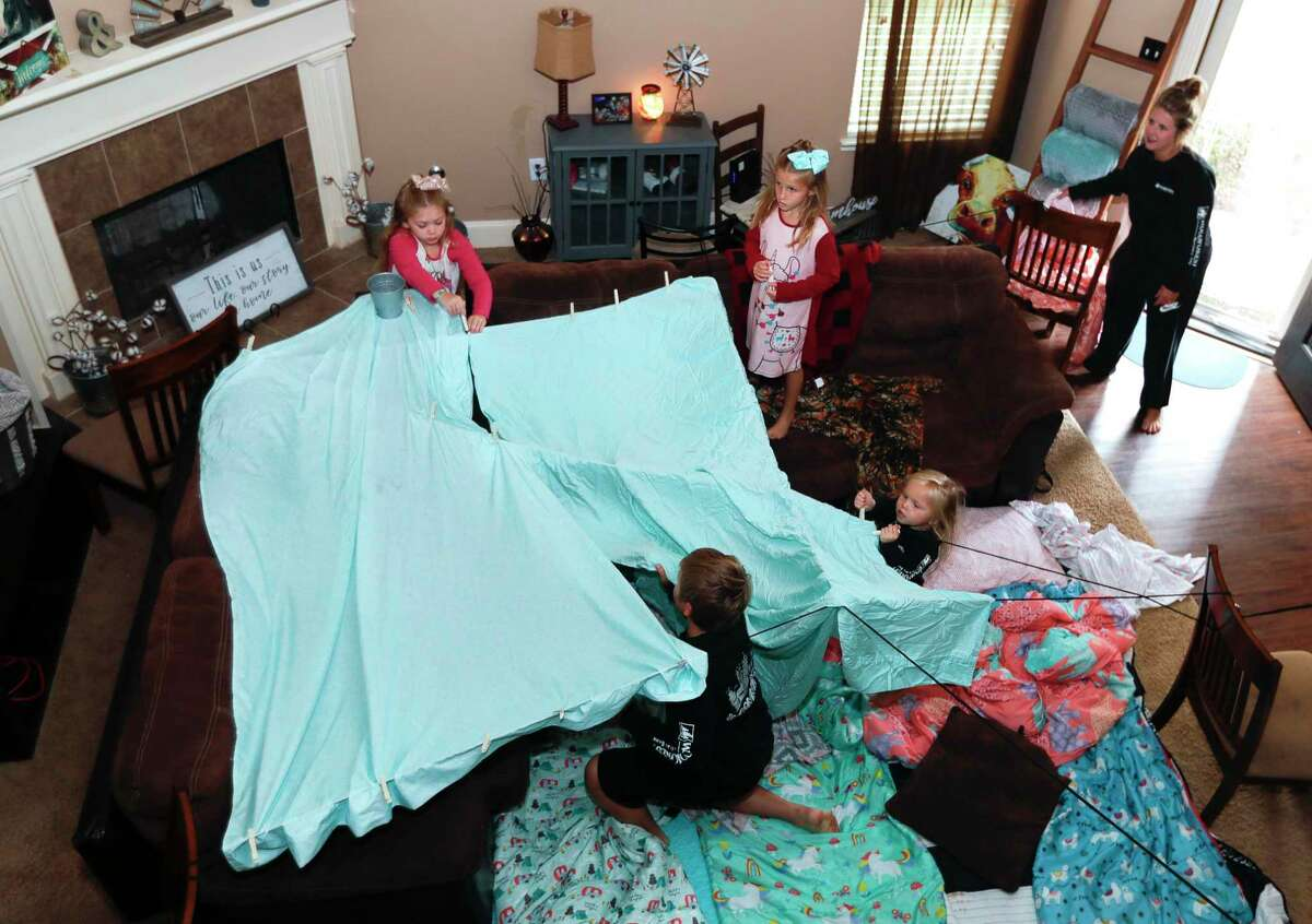 """The Smart family sets up a fort as part of Family Promise of Montgomery County's """"Night Without A Bed"""" initiative Saturday in Montgomery. The nationwide event raises awareness of families battling homelessness."""