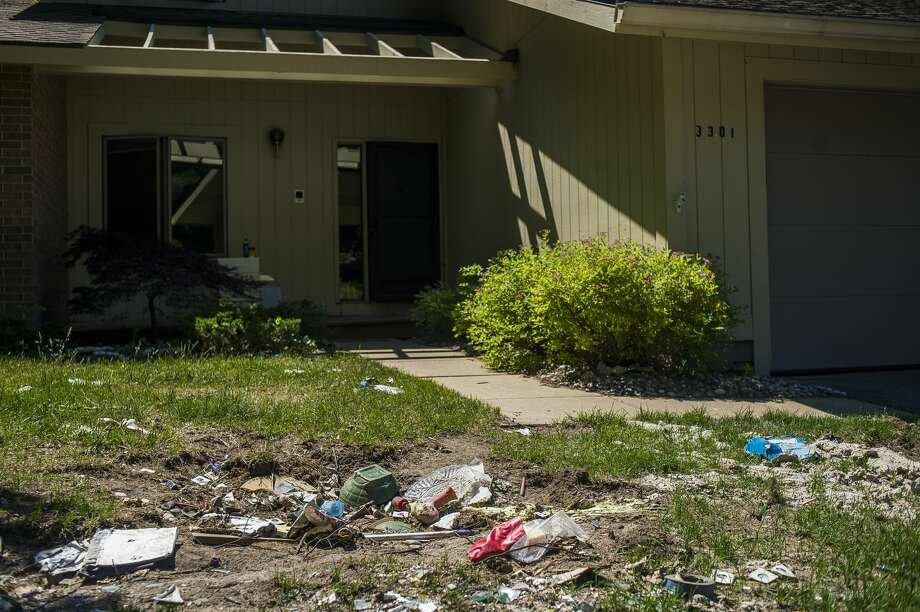 Debris lies in the front lawn of a home at Village West Condominiums Wednesday, June 17, 2020. (Katy Kildee/kkildee@mdn.net) Photo: (Katy Kildee/kkildee@mdn.net)