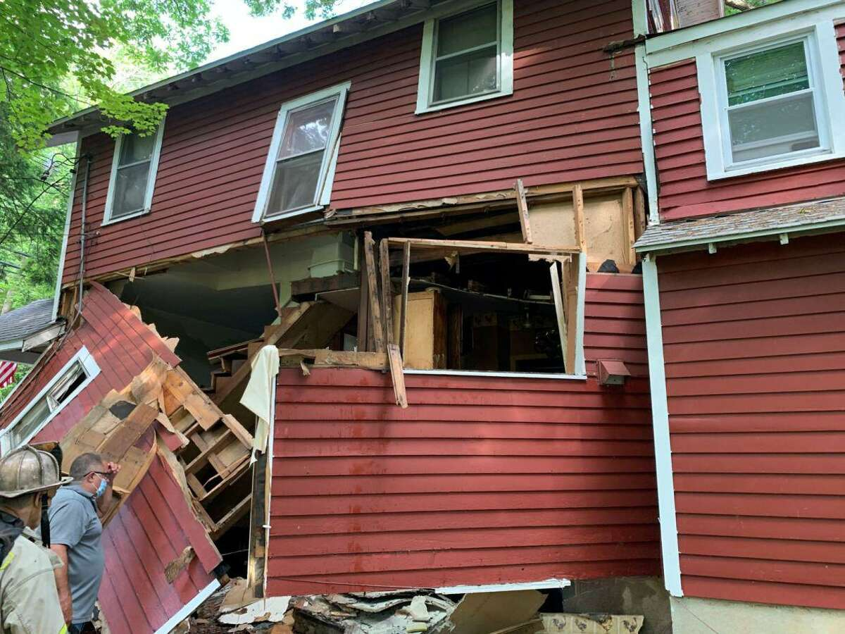 The house at 105 Woodbine Road in Stamford, Conn., partially collapsed after an explosion Saturday, June 20, 2020.