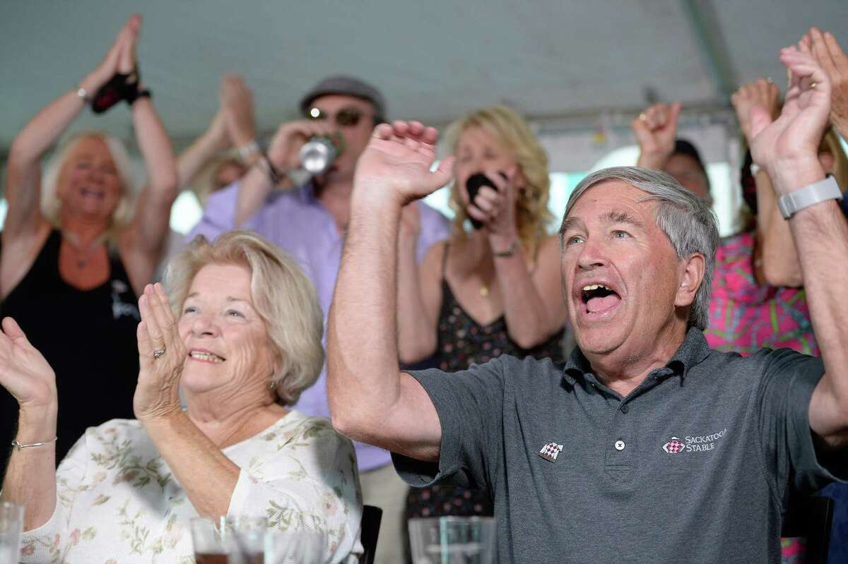 Jack Knowlton, right, operating manager of Sackatoga Stable, which owns Belmont Stakes favorite Tiz the Law, watches the Belmont Stakes with his wife, Dorothy Knowlton, left, at Pennell's Restaurant in Saratoga Springs, N.Y., Saturday, Jun. 20, 2020. (Jenn March, Special to the Times Union)