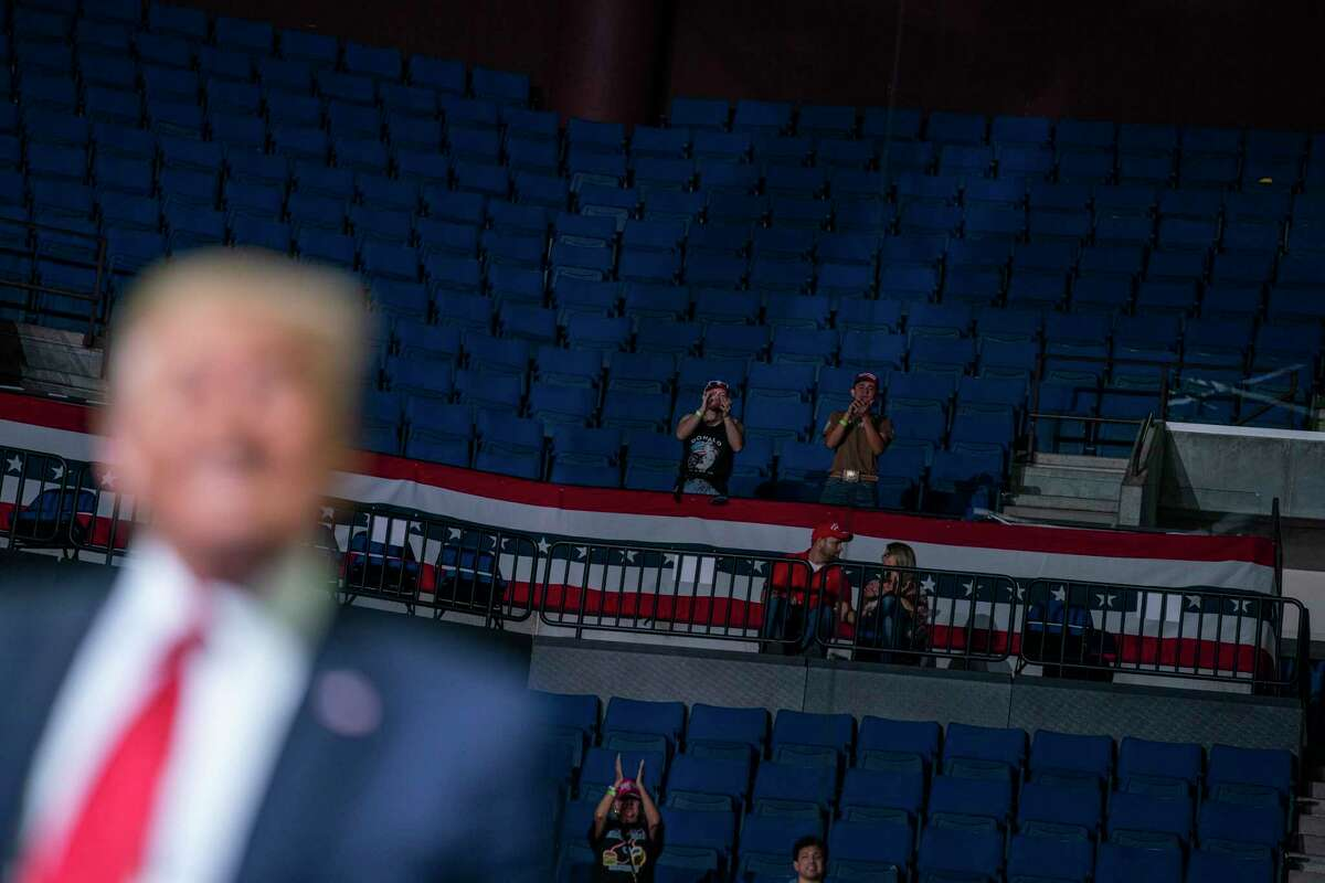 President Donald Trump supporters cheer as Trump speaks during a campaign rally at the BOK Center, Saturday, June 20, 2020, in Tulsa, Okla.