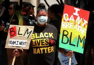 """In the aftermath of George Floyd's murder, Betsy Cuevas, of Bridgeport, joins up with over 100 """"Black Lives Matter"""" protesters to take part in a march from McLevy Green to a rally at nearby Seaside Park in downtown Bridgeport, Conn., on Saturday June 20, 2020."""