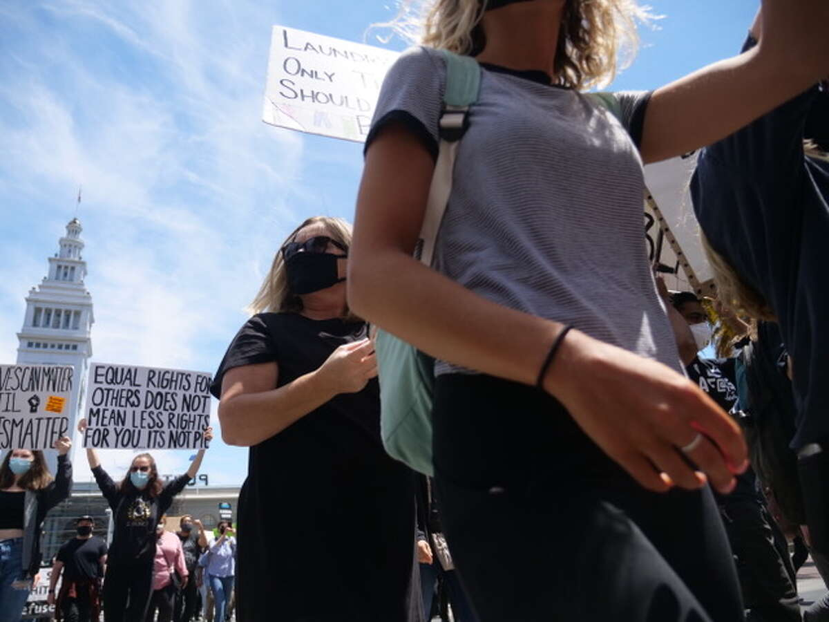 Demonstrators protested in front of San Francisco's Ferry Building for Black Lives Matter in San Francisco, Calif. on June 20, 2020. They then marched to San Francisco City Hall down Market Street. It was one of serveral continuing protests of George Floyd's death by police in Minniapolis, Minn.