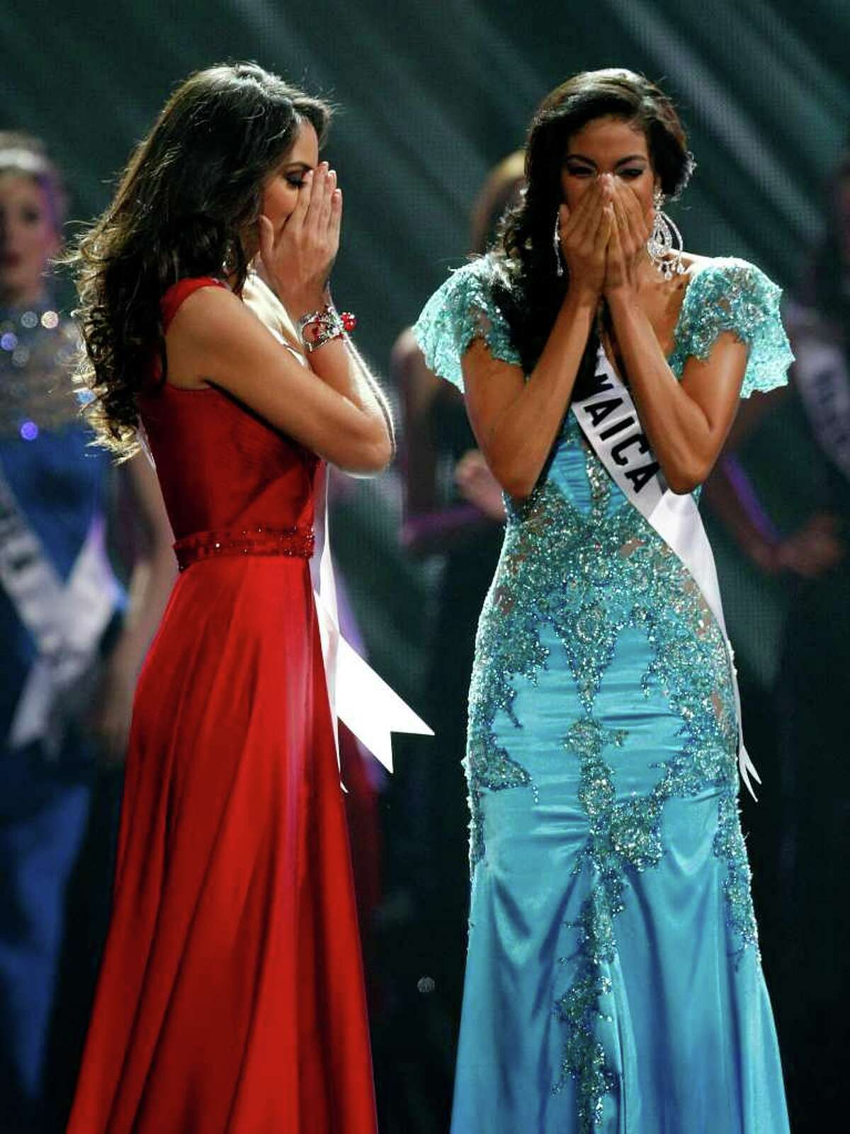 LAS VEGAS - AUGUST 23: Miss Mexico 2010, Jimena Navarrete (L), and Miss Jamaica 2010, Yendi Phillipps, react as Navarette is named the 2010 Miss Universe and Phillipps the first runner-up during the 2010 Miss Universe Pageant at the Mandalay Bay Events Center August 23, 2010 in Las Vegas, Nevada. (Photo by Ethan Miller/Getty Images)