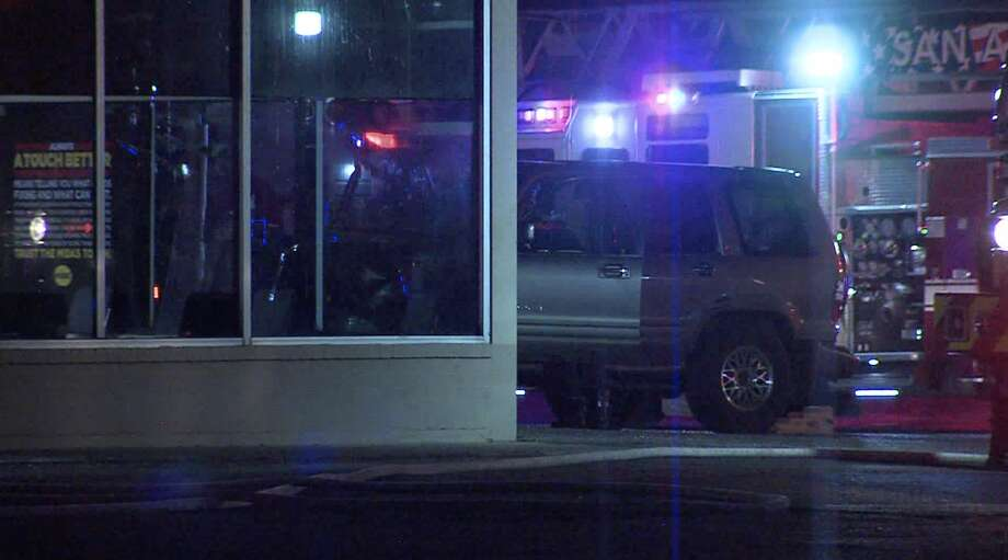 According to police, a man lost control of his vehicle and crashed into a Midas Break Shop on the South Side early Sunday morning. Photo: 21 Pro Video