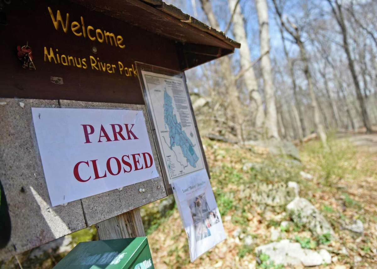 A closed sign is displayed at the entrance of the Greenwich-owned section of Mianus River Park in Stamford, Conn. Wednesday, April 1, 2020. The park consists of three sections - the 110-acre Mianus River & Natural Park owned by Greenwich, the 187-acre Mianus River Park owned by Stamford, and the 94-acre Mianus River State Park, also known as Treetops, owned by the State of Connecticut. The Greenwich portion of the park is closed, the Stamford portion is open, and the state portion could soon limit the number of visitors. The Department of Energy and Environmental Protection announced plans to reduce capacity at popular state parks Wednesday in an effort to ensure social distancing.
