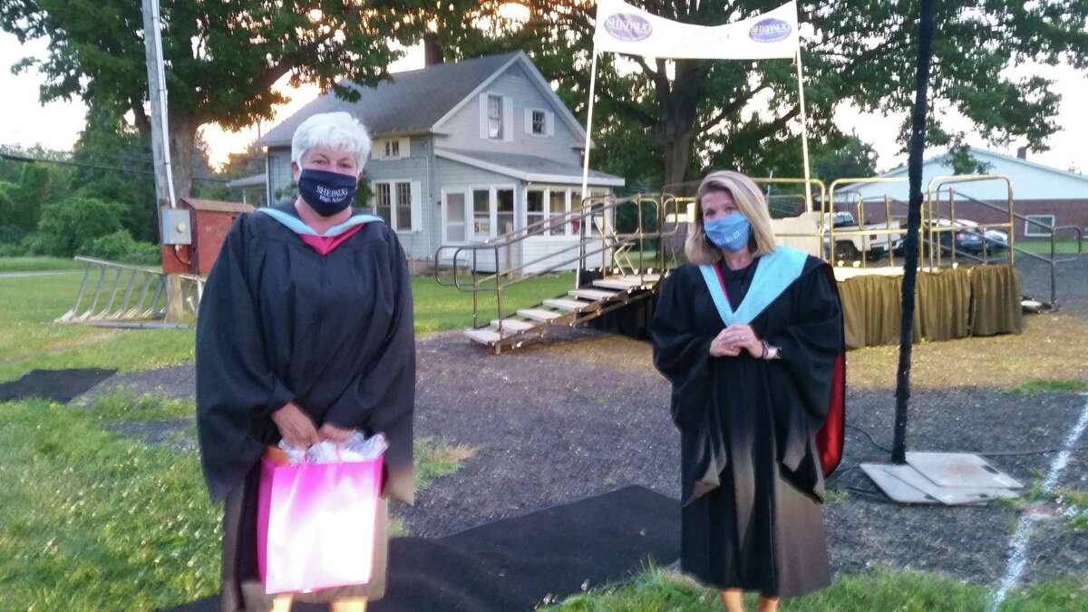 Shepaug principal Kim Gallo (left) and Region 12 superintendent Megan Bennett at Shepaug graduation on Saturday at Bridgewater Fairgrounds. Graduation night began at 7:30 p.m. with a one-hour senior parade through the towns where Shepaug draws their students from Washington, Roxbury and Bridgewater.   The parade arrived at the Bridgewater Fairgrounds, cars were parked in their assigned spaces and the graduation movie began at 9 p.m. Students and parents stayed in their cars during the entire movie except for one brief moment. The movie was paused about half-way through for the students to exit their cars and ceremoniously move the tassels on their cap from one side to the other.