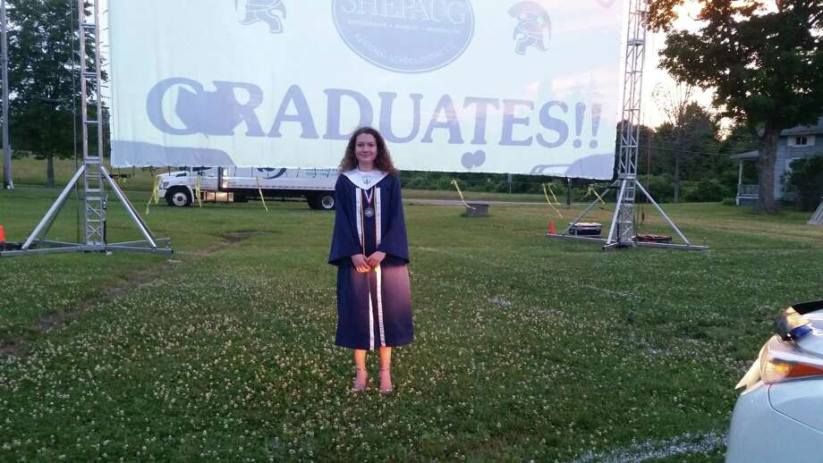 """Shepaug High Valedictorian Isabel Eddy at graduation on Saturday at Bridgewater Fairgrounds It also helps to have a complete television studio as an education tool in your school that can produce that film — Shepaug Communication Assistant Ben Allen produced the movie.  """"The planning for this was a monthlong process involving a large number of people,"""" Shepaug Principal Kim Gallo said. """"We met with the kids a month ago and they told us they didn't want to have their graduation in the fall, they wanted it June 20 with all the seniors together. From that point on, it was just a matter of coming up with the concept and working out the details."""" Photo: Dan Nowak/HearstMediaCT"""