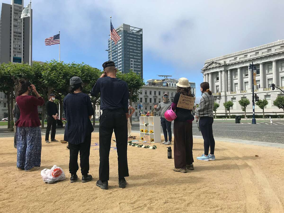 """Buddhist groups prepare to hold a """"sit, walk and listen"""" demonstration near San Francisco's City Hall on Sunday."""