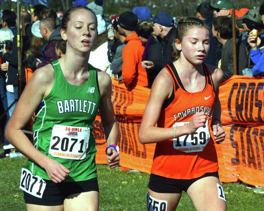 Edwardsville freshman Riley Knoyle, right, runs with Bartlett sophomore Jenna Buchanan during the Class 3A girls state meet Saturday afternoon at Detweiller Park in Peoria. Knoyle earned all-state honors with a 20th-place finish, while Buchanan placed 30th. Photo: Scott Marion|The Intelligencer