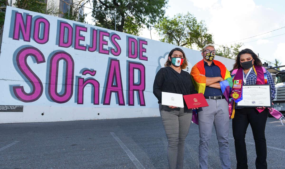 DACA recipients Blanca Margarita Molina, Jose Luis Saldana Cortes and Emilia Janeth Almanza Quistian gather for a photo Saturday, Jun 20, 2020, at a mural in downtown Laredo.
