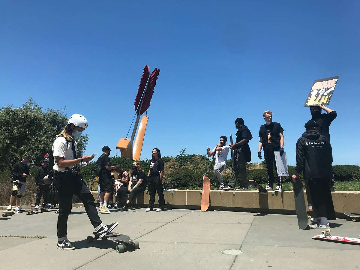 """Skateboarders attend the """"Skate 4 Black Lives"""" rally at Cupid's Span on the Embarcadero in San Francisco on Sunday."""