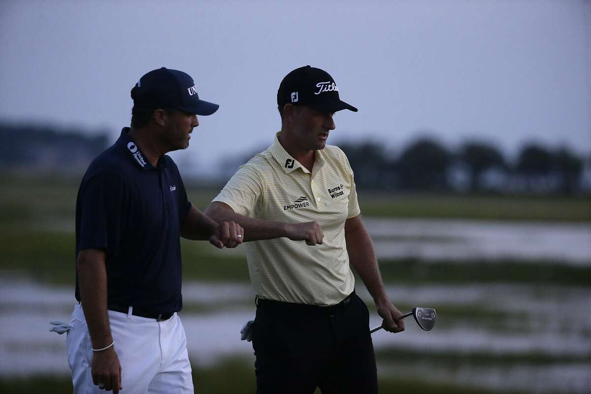 Webb Simpson (right) is congratulated by Ryan Palmer after finishing his round of 7-under-par 64 at Harbour Town.