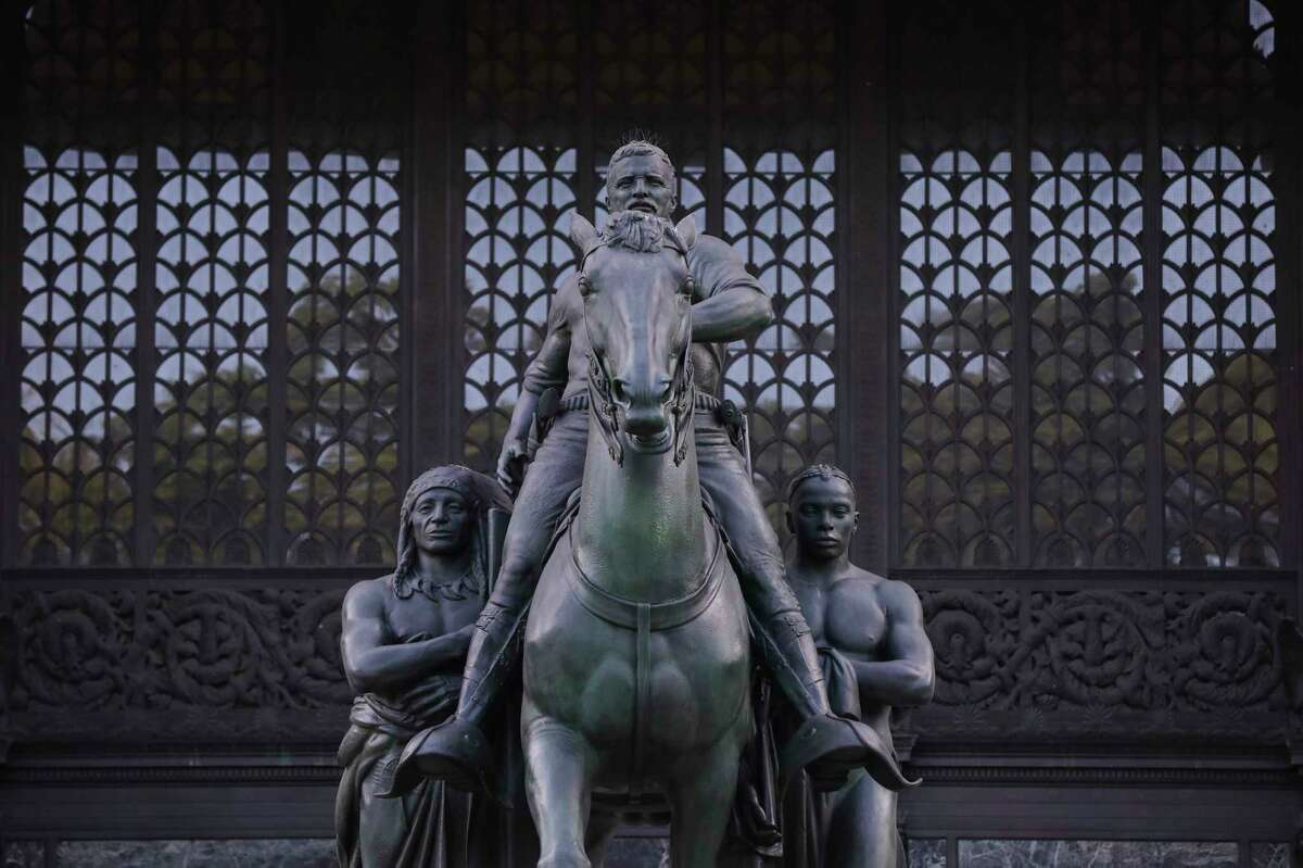 The statue of Theodore Roosevelt outside the Museum of Natural History in New York, June 19, 2020. The equestrian memorial to Roosevelt, which has long prompted objections as a symbol of colonialism and racism, will be coming down. (Caitlin Ochs/The New York Times)