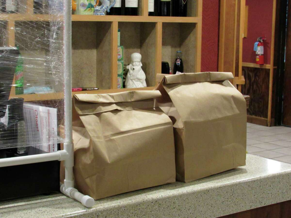 Orders are packed up, ready to go on Saturday, June 20 at Pi's Chinese Restaurant in Midland. The eatery, along with Pi's Asian Express and Genji Midland reopened on Saturday, 10 days after employeesshowed symptoms ofCOVID-19. (Victoria Ritter/vritter@mdn.net)