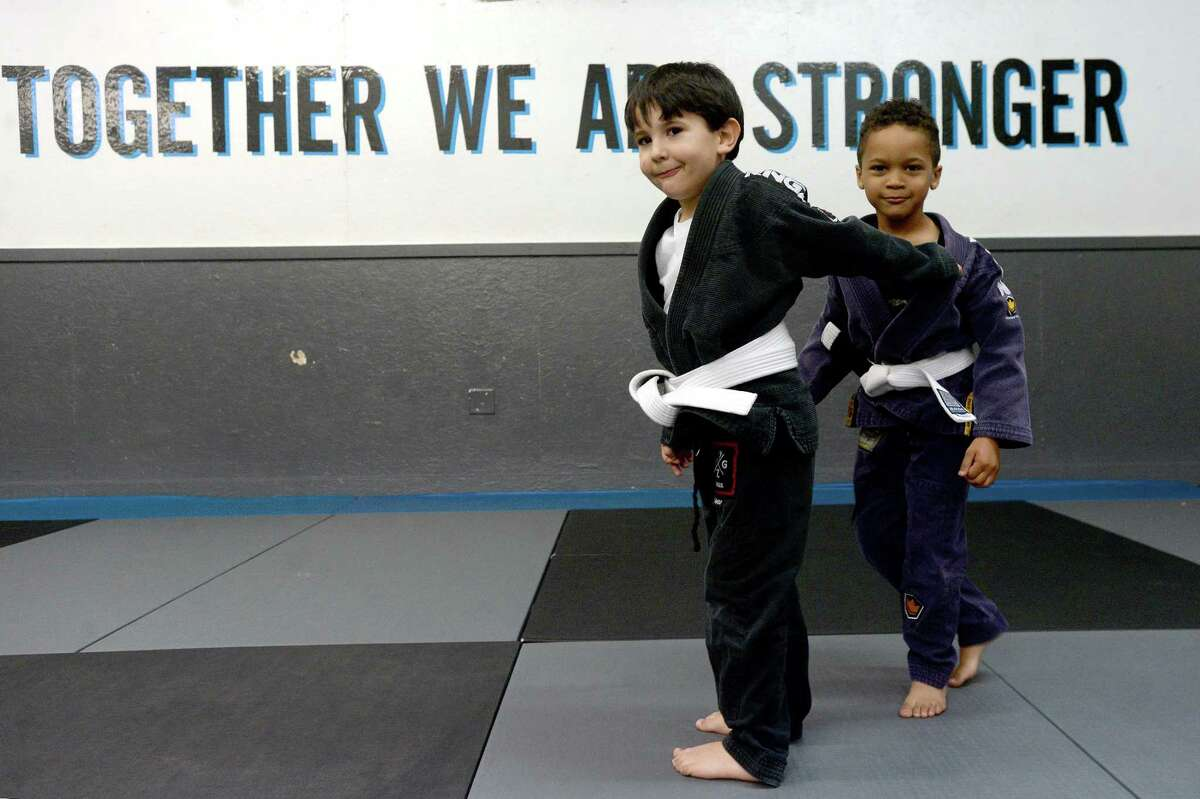 Julian Plasencia and Brayden Barlow pair up to practice during Wednesday's session of a week-long summer camp for kids at Golden Triangle Jiu-Jitsu Academy in Nederland. With Gov. Abbbott moving the state into Phase III of reopening amid COVID-19, area schools and other programs can resume summer camp activities. Photo taken Wednesday, June 10, 2020 Kim Brent/The Enterprise