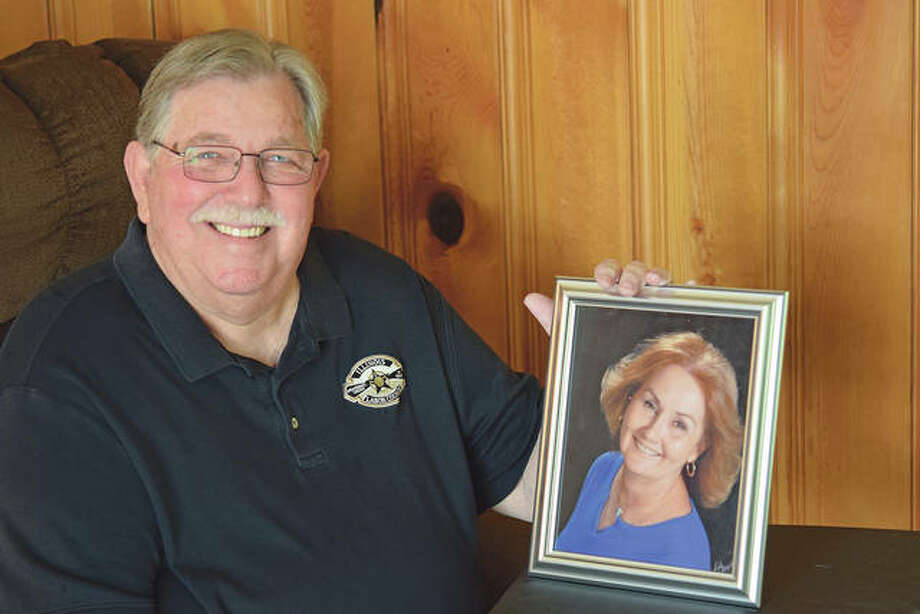 Jerry Lieb with a photo of his late wife, Chardy, after whom an Illinois Fraternal Order of Police memorial award is named. Photo: David Blanchette | Journal-Courier