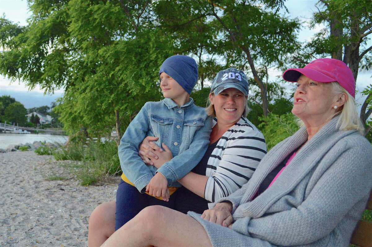 Three generations of Westport ladies including, from left, Lucy Roth, 10, Kerry Long and Priscilla Long, enjoy the sunset at Compo Beach on Thursday, June 18, 2020, in Westport, Conn.
