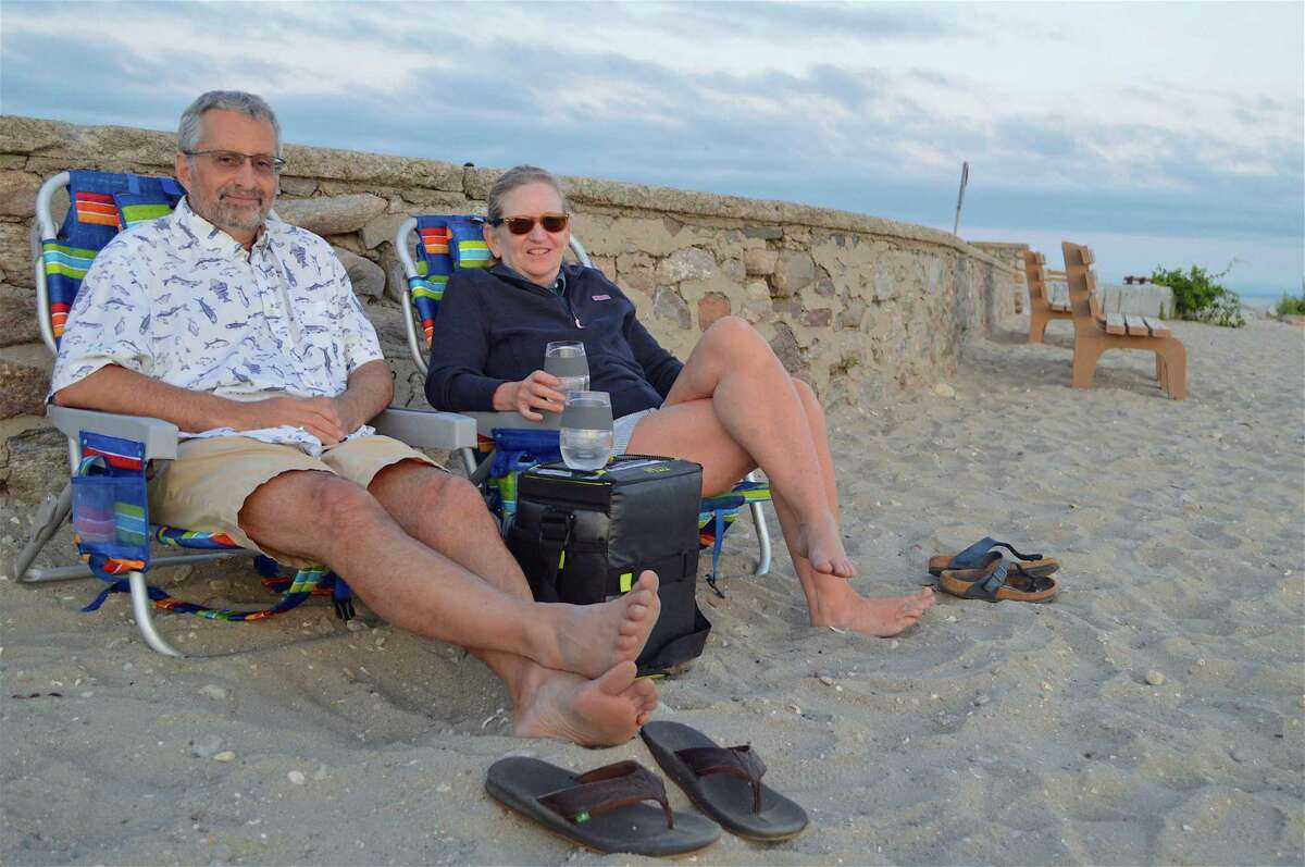 Andrew and Maureen Johnson of Weston have some end-of-day relaxation at Compo Beach on Thursday, June 18, 2020, in Westport, Conn.