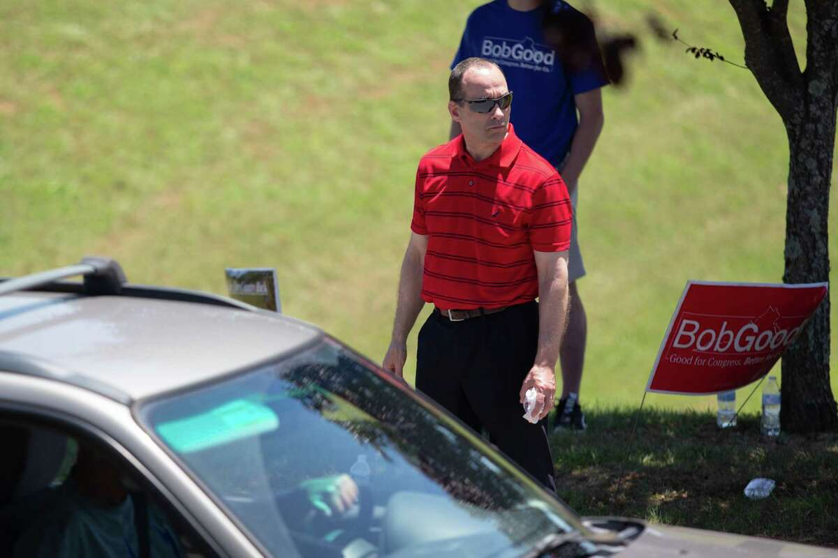 Candidate Bob Good greets delegates as they arrive to cast votes via drive-through lanes at Tree of Life Ministries in Lynchburg, Va., on June 13.